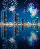 Beautiful fireworks above Dubai Marina bay, UAE. Beautiful fireworks above Dubai Marina bay at night with fireworks, UAE stock photos