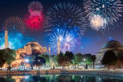 Beautiful fireworks above Hagia Sophia in Istanbul. With reflection on water, Turkey royalty free stock image