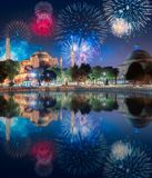 Beautiful fireworks above Hagia Sophia in Istanbul. With reflection on water, Turkey royalty free stock photo