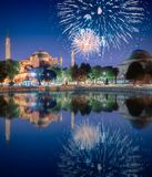 Beautiful fireworks above Hagia Sophia in Istanbul. With reflection on water, Turkey stock image