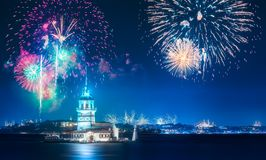 Beautiful fireworks above Maiden Tower in Bosphorus strait Istanbul, Turkey. Beautiful fireworks above Maiden Tower or Kiz Kulesi in Bosphorus at evening time royalty free stock image