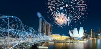 Beautiful fireworks above Marina bay in Singapore. Beautiful fireworks above Marina bay skyline at night in Singapore stock photo