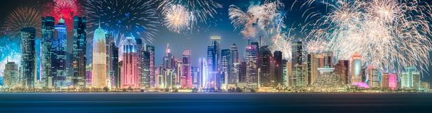 Beautiful fireworks above park in Doha City Center. At night, Qatar royalty free stock photo