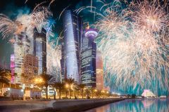 Beautiful fireworks above park in Doha City Center royalty free stock images