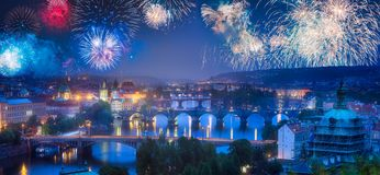 Beautiful fireworks above Prague with bridges on Vltava river. Czech Republic stock photography