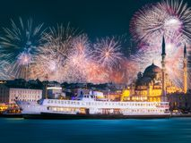 Beautiful fireworks above public ferry and old district of Istanbul royalty free stock image