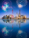 Beautiful fireworks above Shanghai skyline at night. Beautiful fireworks above Shanghai skyline and Huangpu river at night with reflection on water, China royalty free stock photo