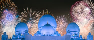 Beautiful fireworks above Sheikh Zayed Grand Mosque at sunset Abu-Dhabi, UAE stock photography