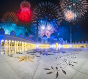 Beautiful fireworks above Sheikh Zayed Grand Mosque at sunset Abu-Dhabi, UAE. Beautiful fireworks above Sheikh Zayed Grand Mosque at night, Abu-Dhabi, UAE royalty free stock image