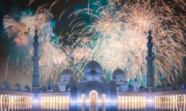 Beautiful fireworks above Sheikh Zayed Grand Mosque at sunset Abu-Dhabi, UAE. Beautiful fireworks above Sheikh Zayed Grand Mosque at night, Abu-Dhabi, UAE stock image