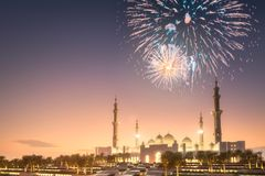 Beautiful fireworks above Sheikh Zayed Grand Mosque at sunset Abu-Dhabi, UAE. Beautiful fireworks above Sheikh Zayed Grand Mosque at night, Abu-Dhabi, UAE royalty free stock photography