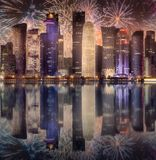 Beautiful fireworks above skyline of West Bay and Doha City, Qatar. Beautiful fireworks above skyline of West Bay and Doha City Center at night, Qatar royalty free stock photography