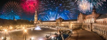 Beautiful fireworks above Spain Square on sunset, Seville. Beautiful fireworks above Spain Square on sunset, landmark in Renaissance Revival style, Seville royalty free stock photos