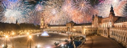 Beautiful fireworks above Spain Square on sunset, Seville. Beautiful fireworks above Spain Square on sunset, landmark in Renaissance Revival style, Seville stock photo