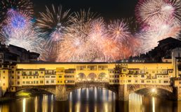 Beautiful fireworks above Vecchio Bridge, Florence. Beautiful fireworks above Ponte Vecchio Bridge Florence, Italy royalty free stock photos