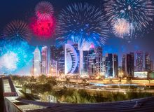 Beautiful fireworks above West Bay and Doha City, Qatar. Beautiful fireworks above West Bay and Doha City Center at night, Qatar royalty free stock photos