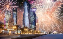 Beautiful fireworks above West Bay and Doha City, Qatar. Beautiful fireworks above West Bay and Doha City Center at night, Qatar royalty free stock image