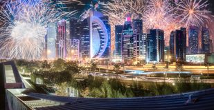 Beautiful fireworks above West Bay and Doha City, Qatar. Beautiful fireworks above West Bay and Doha City Center at night, Qatar royalty free stock photo