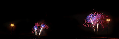 Beautiful fireworks against night black sky Royalty Free Stock Image