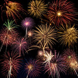 Beautiful fireworks display lights up the night time sky. Beautiful fireworks fill the night time sky Stock Photography