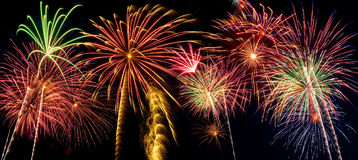 Beautiful fireworks display lights up the night time sky. Beautiful fireworks fill the night time sky Royalty Free Stock Photos