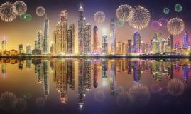 Beautiful fireworks in Dubai marina. UAE. The beauty panorama of skyscrapers in Dubai Marina with fireworks. UAE Stock Images