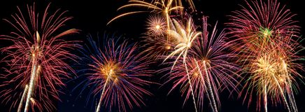 Beautiful fireworks display lights up the night time sky. Beautiful fireworks fill the night time sky Stock Images
