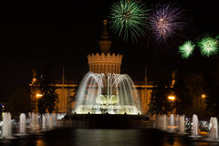 Beautiful fireworks and fountain Royalty Free Stock Image
