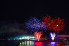 Beautiful fireworks in Genoa, Italy, with reflections on the sea royalty free stock photography
