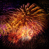 Beautiful fireworks in a night sky Royalty Free Stock Photo