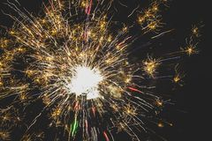 Beautiful fireworks in the night sky close-up. Bright explosion of festive fireworks on a dark background royalty free stock images