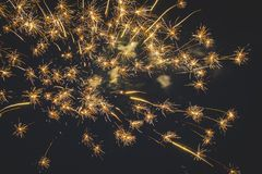 Beautiful fireworks in the night sky close-up. Bright explosion of festive fireworks on a dark background.  royalty free stock photography