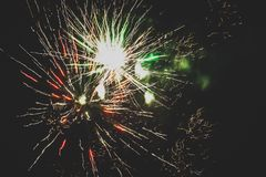Beautiful fireworks in the night sky close-up. Bright explosion of festive fireworks on a dark background.  royalty free stock images