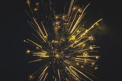 Beautiful fireworks in the night sky close-up. Bright explosion of festive fireworks on a dark background royalty free stock photos