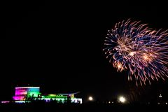 Beautiful fireworks over the building at night. In the holiday Stock Photos