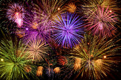 Beautiful fireworks show on clear night sky. Stock Photos