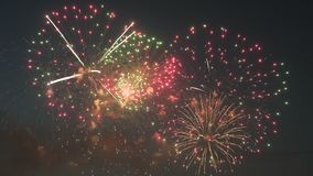 Beautiful fireworks show in the night sky. Hd stock video footage
