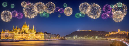 Beautiful fireworks under hungarian Parliament and Liberty Statue. Beautiful fireworks under hungarian Parliament building and Liberty Statue at night in Stock Photo