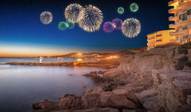 Beautiful fireworks under Ibiza island night view Stock Photos