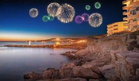 Beautiful fireworks under Ibiza island night view Stock Photos