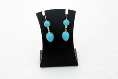 Beautiful firozi turquoise gemstone silver ear rings Royalty Free Stock Photos