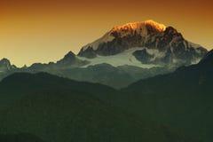 Beautiful first light from sunrise on Mount Kanchenjugha, Himalaya, Sikkim, India. Stock Photos