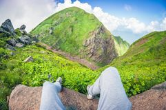 Beautiful first-person view from a high mountain, fisheye distortion POV. Beautiful first-person view from a high mountain, with legs in the frame, fisheye stock photos