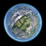 Beautiful fish eye aerial shot in globe formation with a blue outline on a dark background