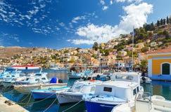 Beautiful fishing boat lined harbor at Symi, Greece Royalty Free Stock Image