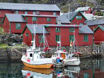 Beautiful fishing harbor in Norway. Postcard from Norway - typical small fishing harbour Stock Photos