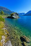 Beautiful fishing house on fjord. Beautiful nature with blue sky, reflection in water and fishing house. Norway. Beautiful fishing house on fjord. Beautiful royalty free stock photography