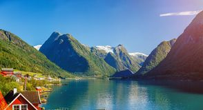 Beautiful fishing houses on fjord. Beautiful nature with blue sky, reflection in water and fishing house. Norway. Beautiful fishing red houses on fjord royalty free stock photos