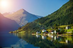 Beautiful fishing houses on fjord. Beautiful nature with blue sky, reflection in water and fishing house. Norway. Beautiful fishing houses on fjord. Beautiful stock images