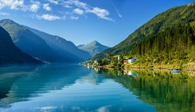 Beautiful fishing houses on fjord. Beautiful nature with blue sky, reflection in water and fishing house. Norway. Beautiful fishing houses on fjord. Beautiful royalty free stock images